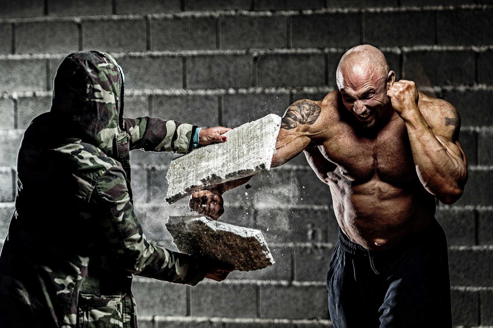 man punching block